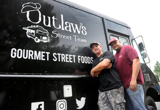 Ryan Briggs (left), owner of Outlaw's Burger Barn & Creamery, and chef Antonio Torres gave back to the community by serving free food at Landis Avenue and the Boulevard in Vineland on Monday, September 24.