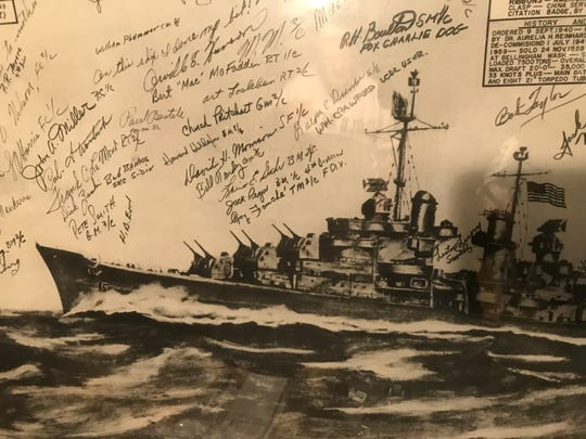 Close up a poster of the USS Oakland, signed by some of Robert Almquist's shipmates. The poster hangs in Almquist's office on the second floor of his Wisconsin Rapids home.