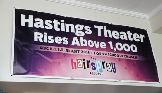 """A banner for Hastings High School's """"The Hairspray Project,"""" which won a $10K NBC grant, hangs in the school's lobby. Hastings is inviting students from across the Lower Hudson Valley to audition for the musical, about the integration of a teen-dance TV show in 1962 Baltimore."""