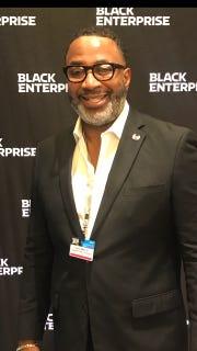 Darryl Mack, Sr., an assistant principal at Riverside High School, was given an award by the organization Black Enterprise.