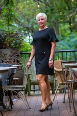 Theresa Varela wears a black Tommy Hilfiger dress with Cole Hahn calf hair pumps.