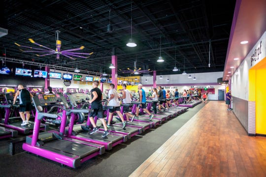 The interior of a Planet Fitness gym.