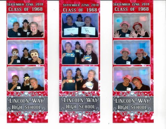 Joyce, Shirley, and Susan having fun in the reunion photo booth.