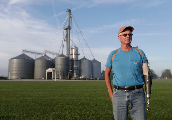 "Jack Maloney poses in front of the grain bins on his Little Ireland Farms in Brownsburg, Ind.. Maloney, who farms about 2,000 acres in Hendricks Count, said the aid for farmers is ""a nice gesture"" but what farmers really want is free trade, not government handouts."