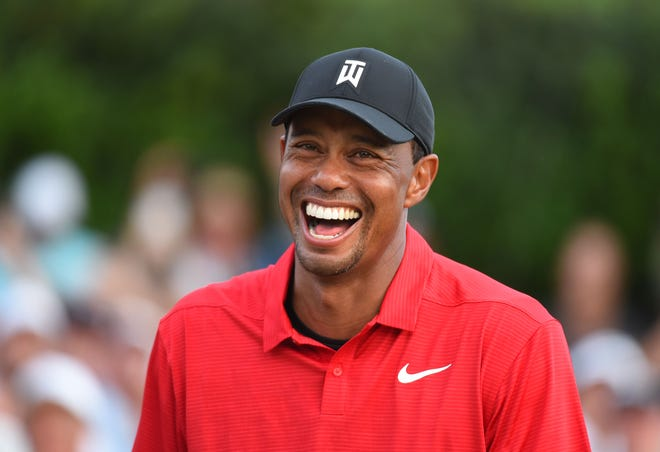 Tiger Woods reacts after winning the Tour Championship, his first victory in five years.