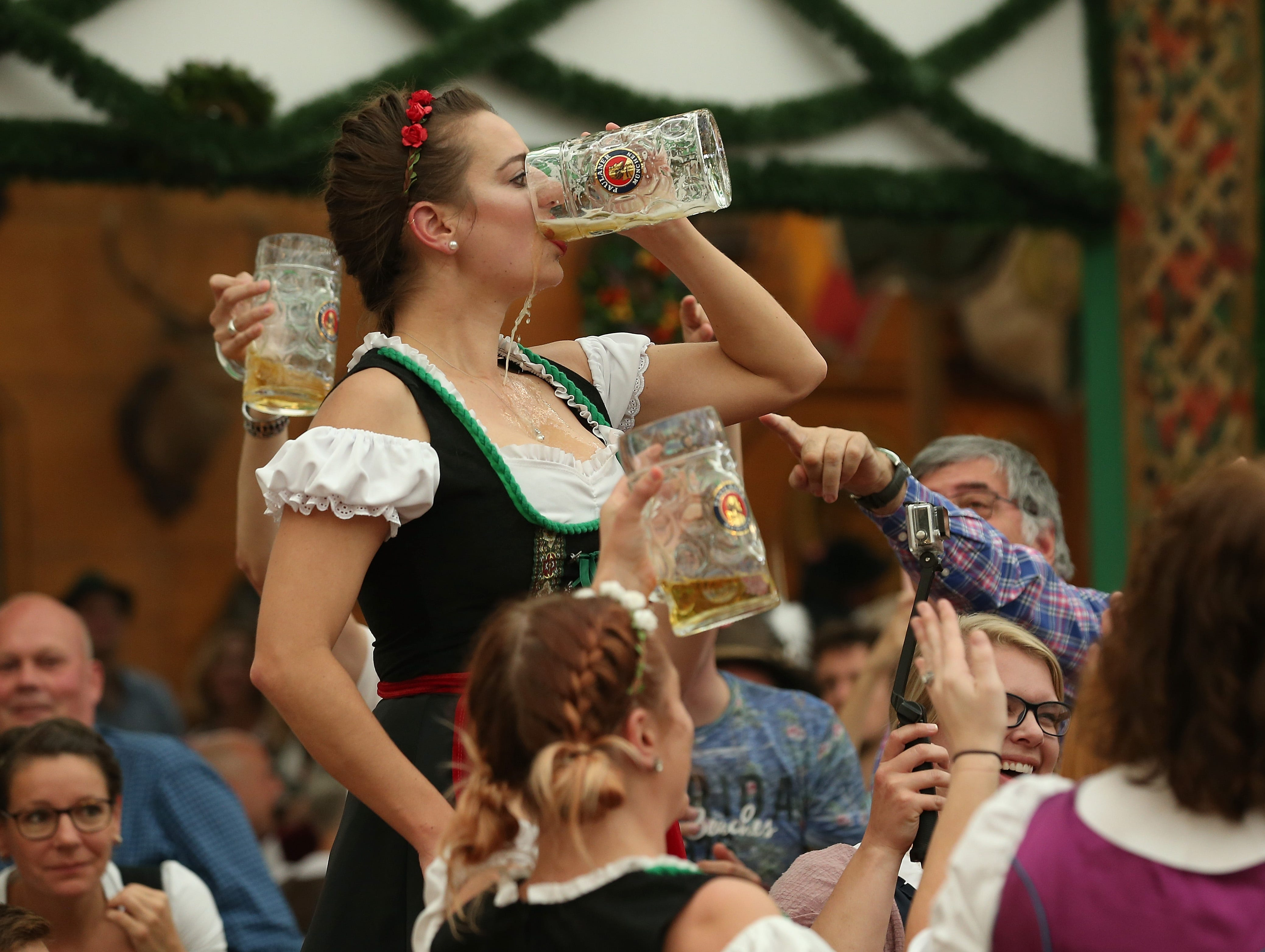 A female reveler from the USA downs her beer in the Armbrustschuetzenzelt tent on the second day of the 2018 Oktoberfest beer festival on Sept. 23, 2018 in Munich, Germany.