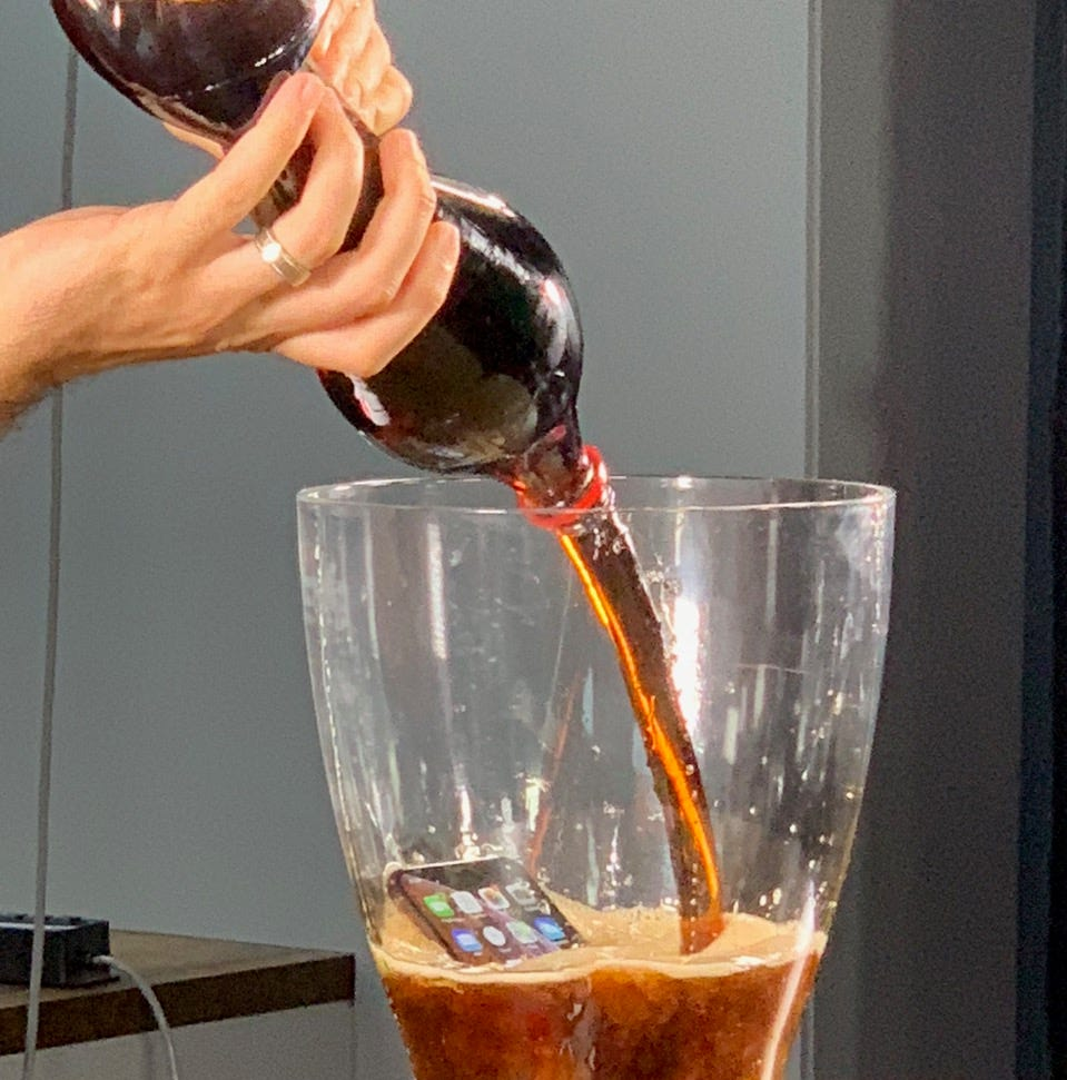 We dropped a thirsty iPhone XS into coffee, wine, beer and soda: Here's how it did