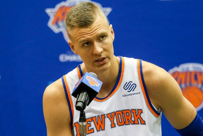 Kristaps Porzingis said he is taking his time rehabbing his knee and wouldn't guarantee he would play this year.