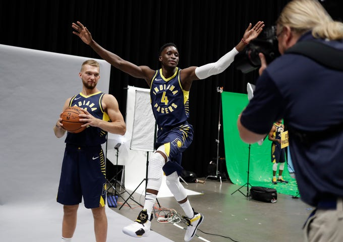 Victor Oladipo (4) photo bombs Indiana Pacers teammate Domantas Sabonis during a shoot with photographer Trevor Ruszkowski during media.