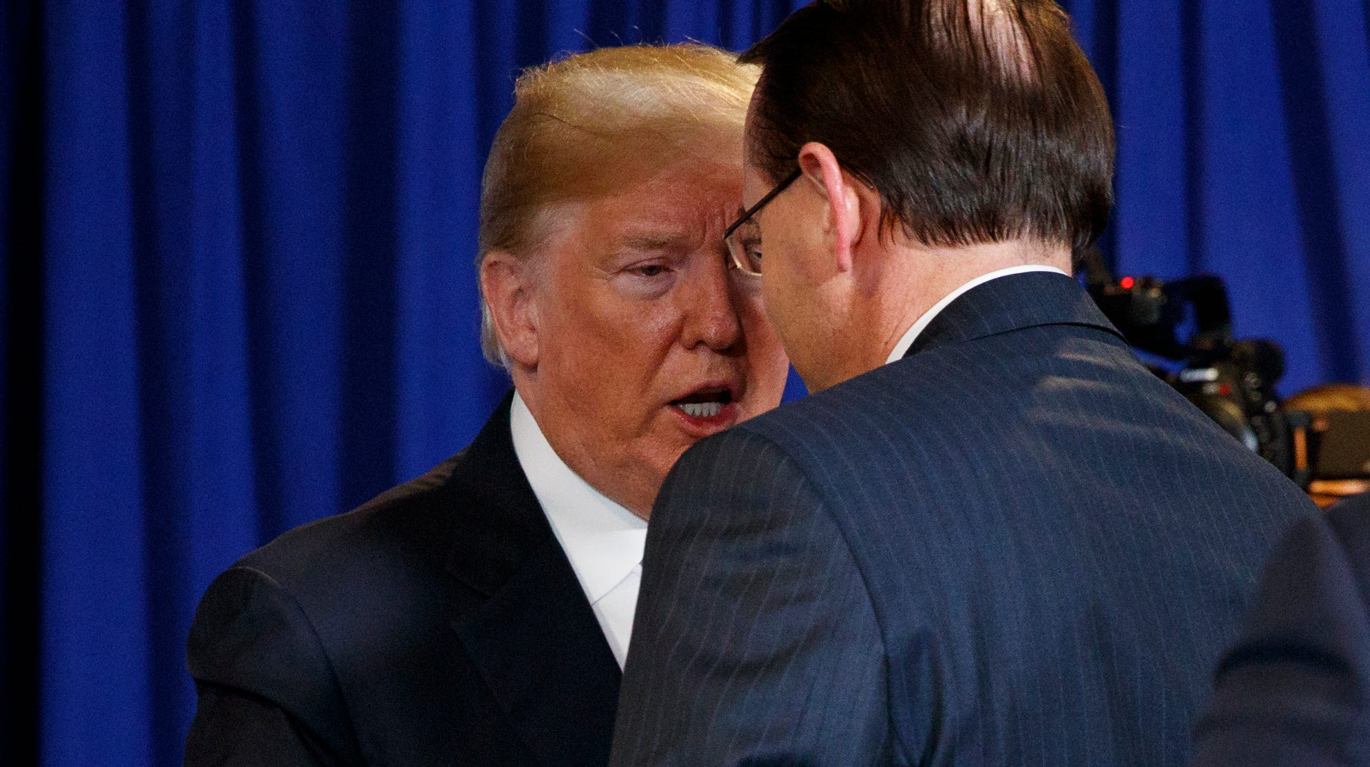 President Donald Trump shakes hands with Deputy Attorney General Rod Rosenstein at a policy event in May.
