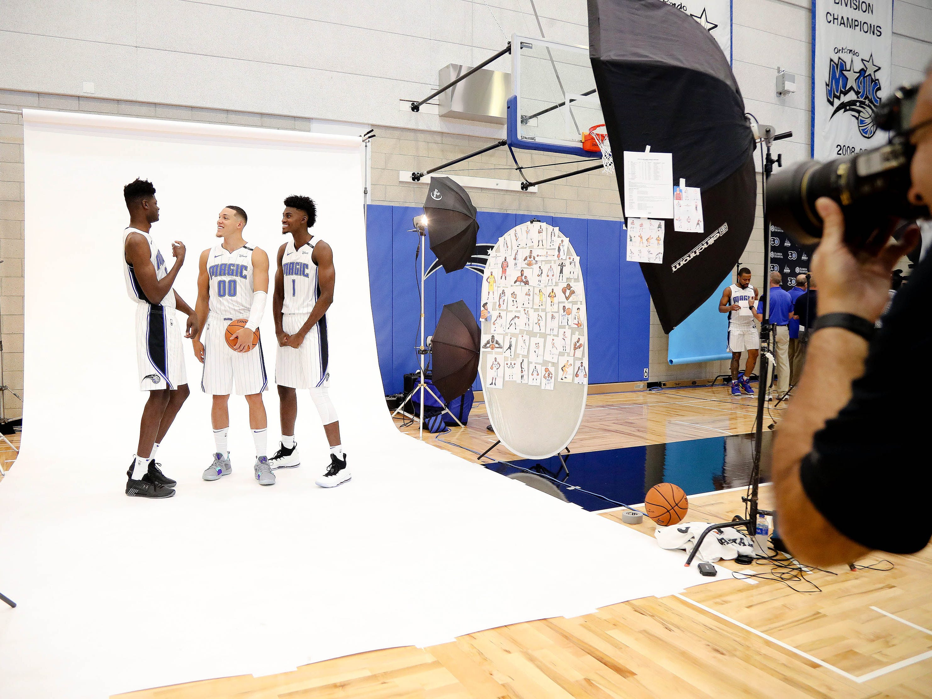 Orlando Magic center Mohamed Bamba (5), forward Aaron Gordon (00) and forward Jonathan Isaac (1) get ready to pose for a photo.