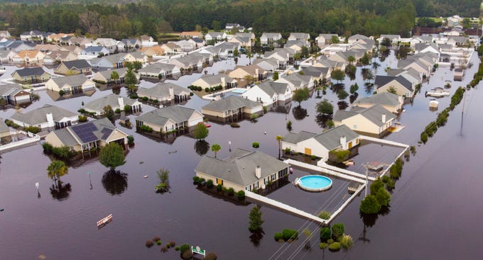 The Polo Farms neighborhood off S.C. Highway 905 is largely underwater, on Monday, Sept. 24, 2018, in Longs, S.C.