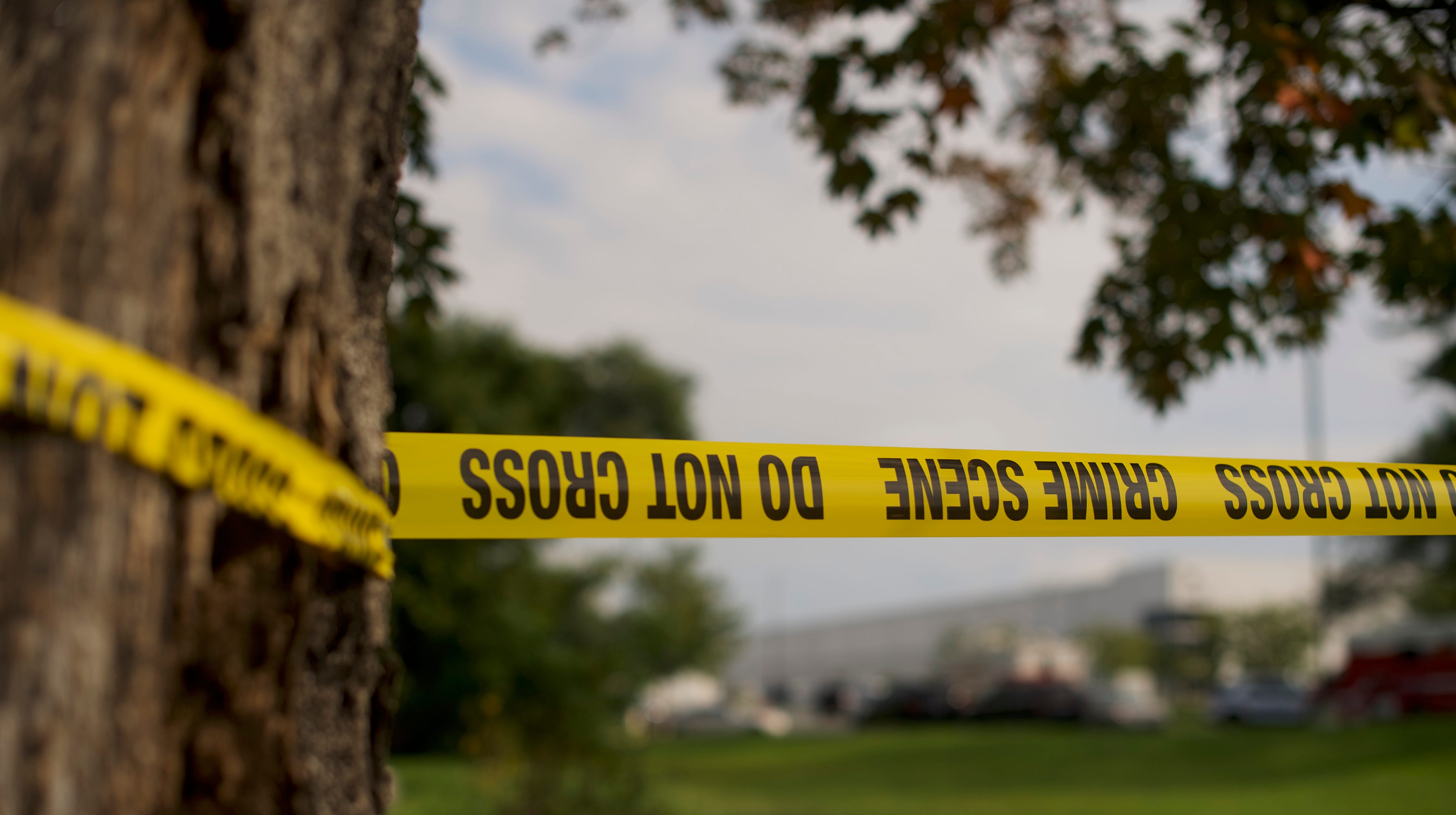 Crime-scene tape flutters in the wind in front of a Rite Aid Distribution Center, where multiple people were killed and injured in a shooting, on Sept. 20, 2018 in Aberdeen, Maryland.