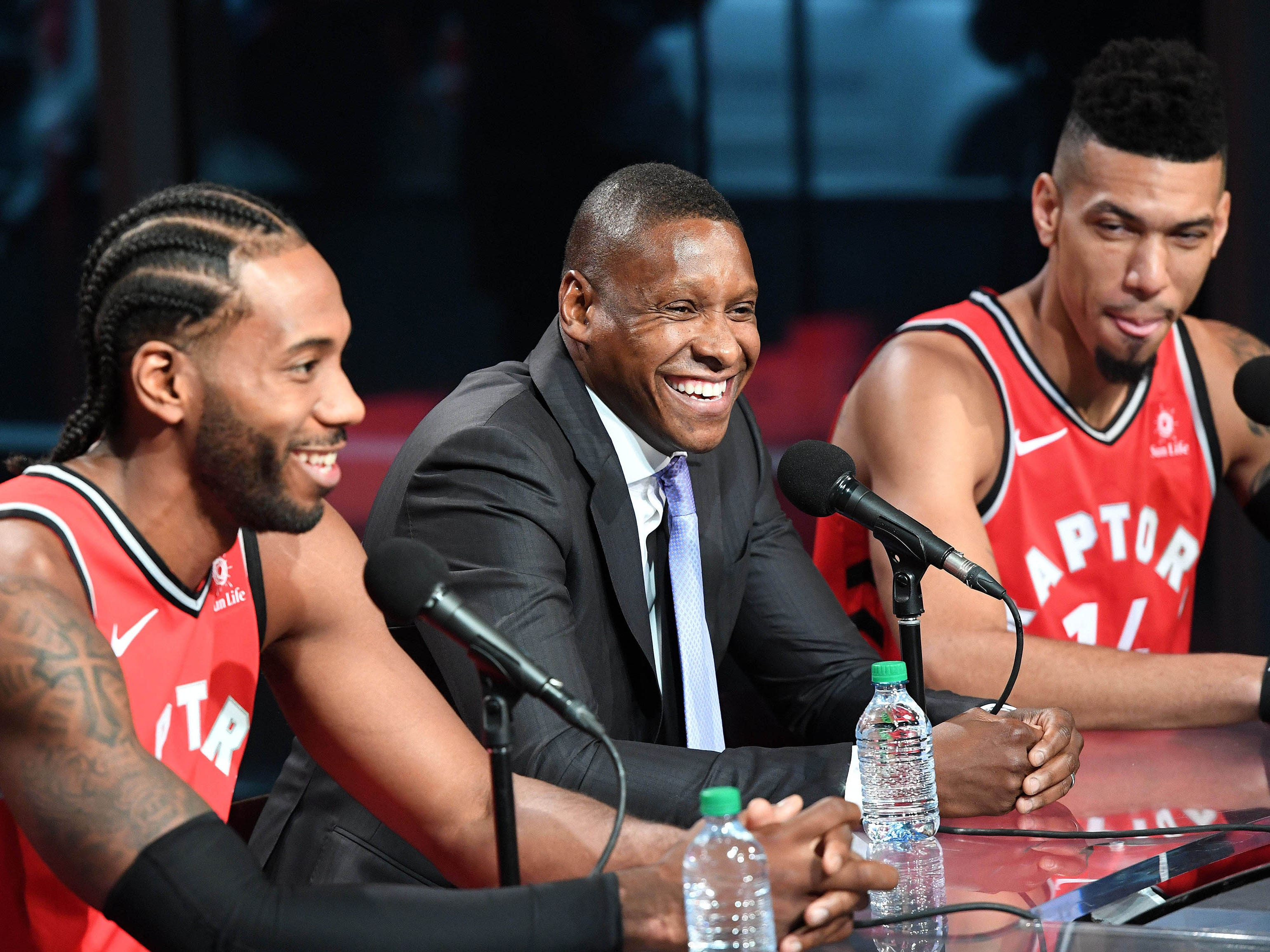 Toronto Raptors forward Kawhi Leonard (2) answers questions as club president Masai Ujiri and guard Danny Green react during media day.