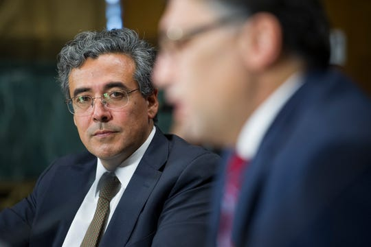 Solicitor General nominee Noel Francisco, left, looks at Assistant Attorney General, Antitrust Division nominee Makan Delrahim as they testify before the Senate Judiciary Committee's hearing on their nominations, on Capitol Hill in Washington on May 10, 2017.