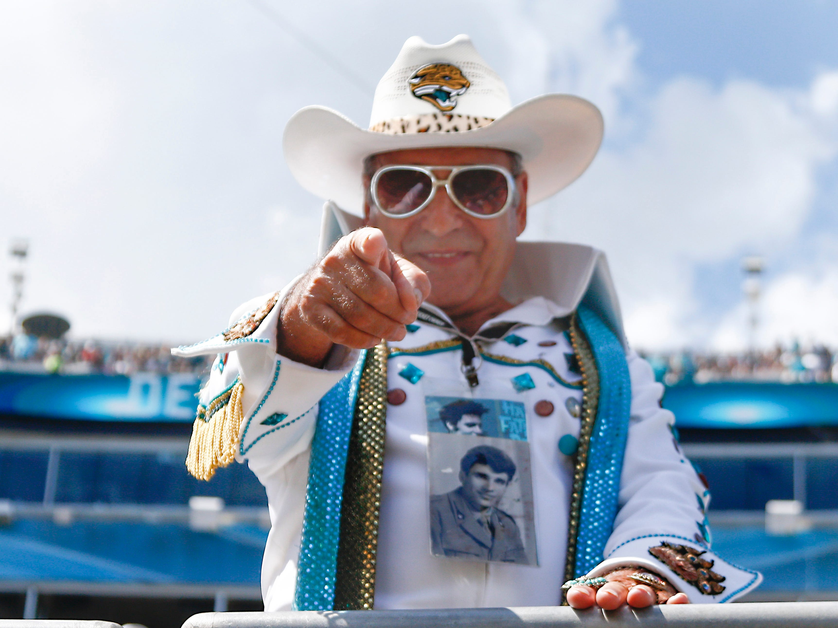 An Elvis clad fan cheers during the game between the Jacksonville Jaguars and the Tennessee Titans at TIAA Bank Field.