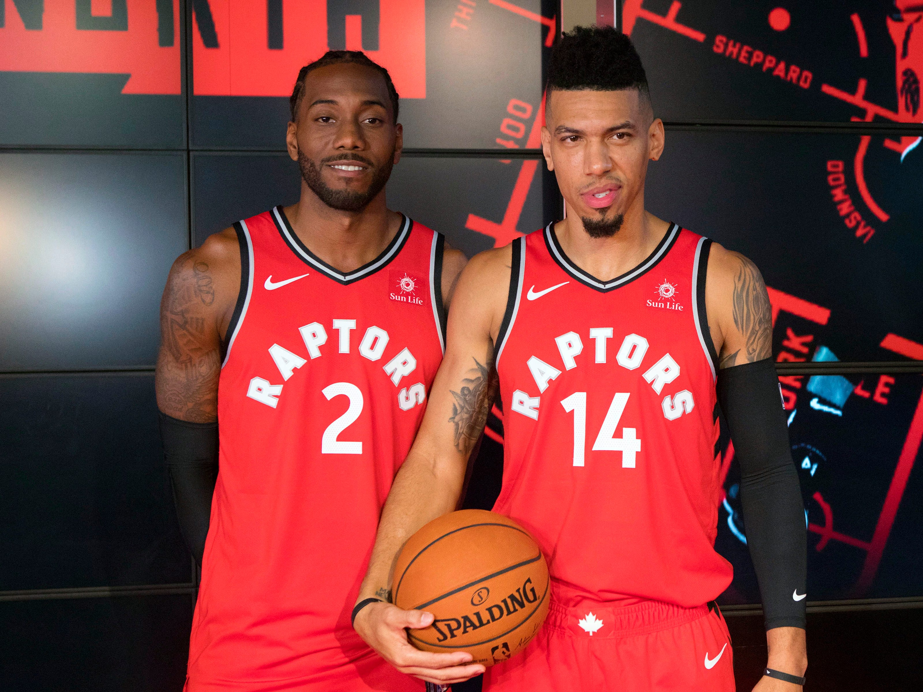 Toronto Raptors players Kawhi Leonard, left, and Danny Green pose for a photo during media day in Toronto.