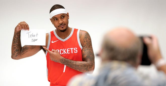 Carmelo Anthony lends a helping hand during a media day photo shoot.