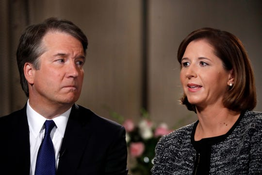 Brett Kavanaugh, left, looks at his wife Ashley Estes Kavanaugh as they answer questions during a FOX News interview, Monday, Sept. 24, 2018, in Washington, about allegations of sexual misconduct against the Supreme Court nominee.