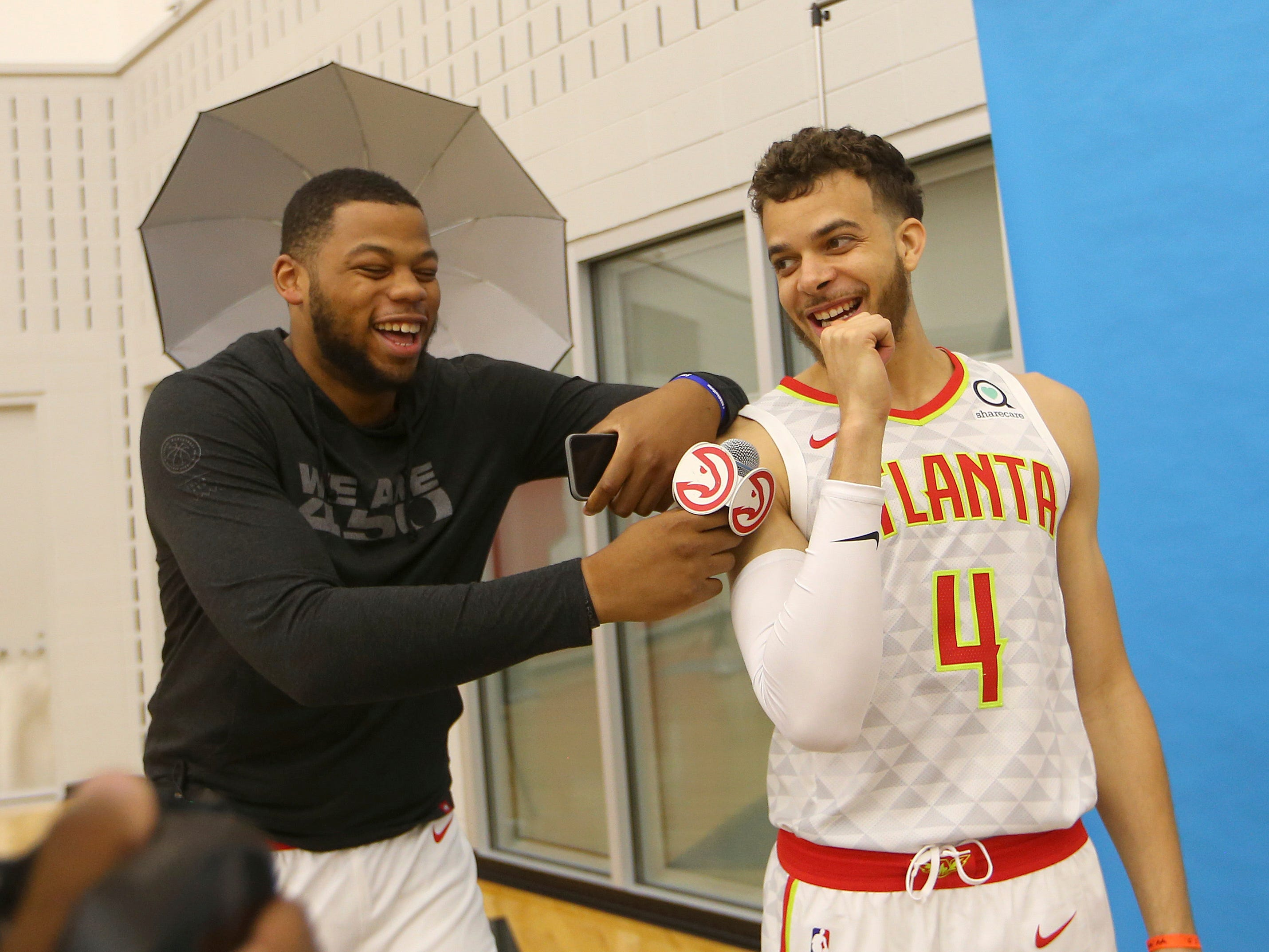 The Atlanta Hawks' Omari Spellman, left, interviews teammate R.J. Hunter (4) during media day.