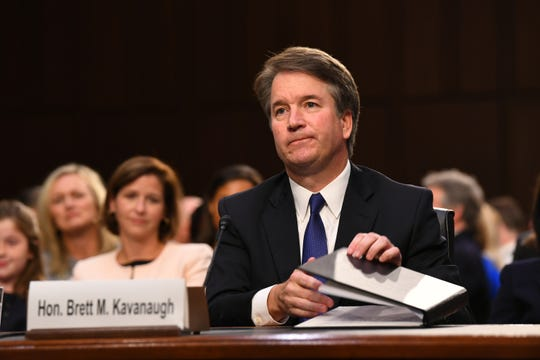Supreme Court nominee Brett Kavanaugh, backed up here by his wife Ashley, sat for three straight days before the Senate Judiciary Committee in early September.