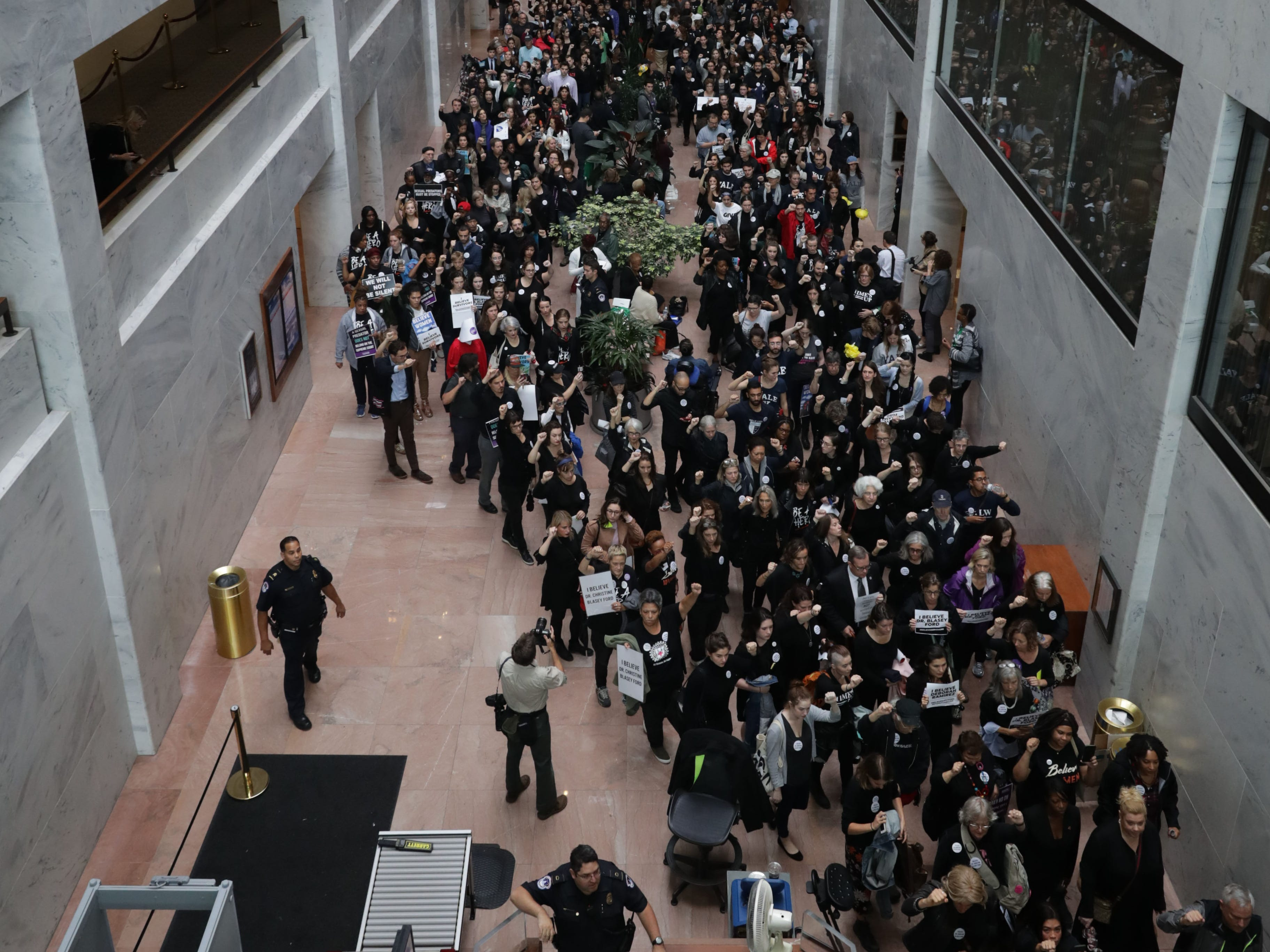 WASHINGTON, DC - SEPTEMBER 24: Hundreds of protesters rally in the Hart Senate Office Building while demonstrating against the confirmation of Supreme Court nominee Judge Brett Kavanaugh on Capitol Hill September 24, 2018 in Washington, DC. Hundreds of people from half a dozen progressive organizations, including students from Yale University Law School, protested on Capitol Hill for a #BelieveSurvivors Walkout against Judge Kavanaugh, who has been accused by at least two women of sexual assault. (Photo by Chip Somodevilla/Getty Images) ORG XMIT: 775232425 ORIG FILE ID: 1043782668