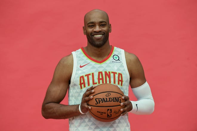 Atlanta Hawks player Vince Carter poses for photos during Hawks Media Day at the Emory Sports Medicine Complex.
