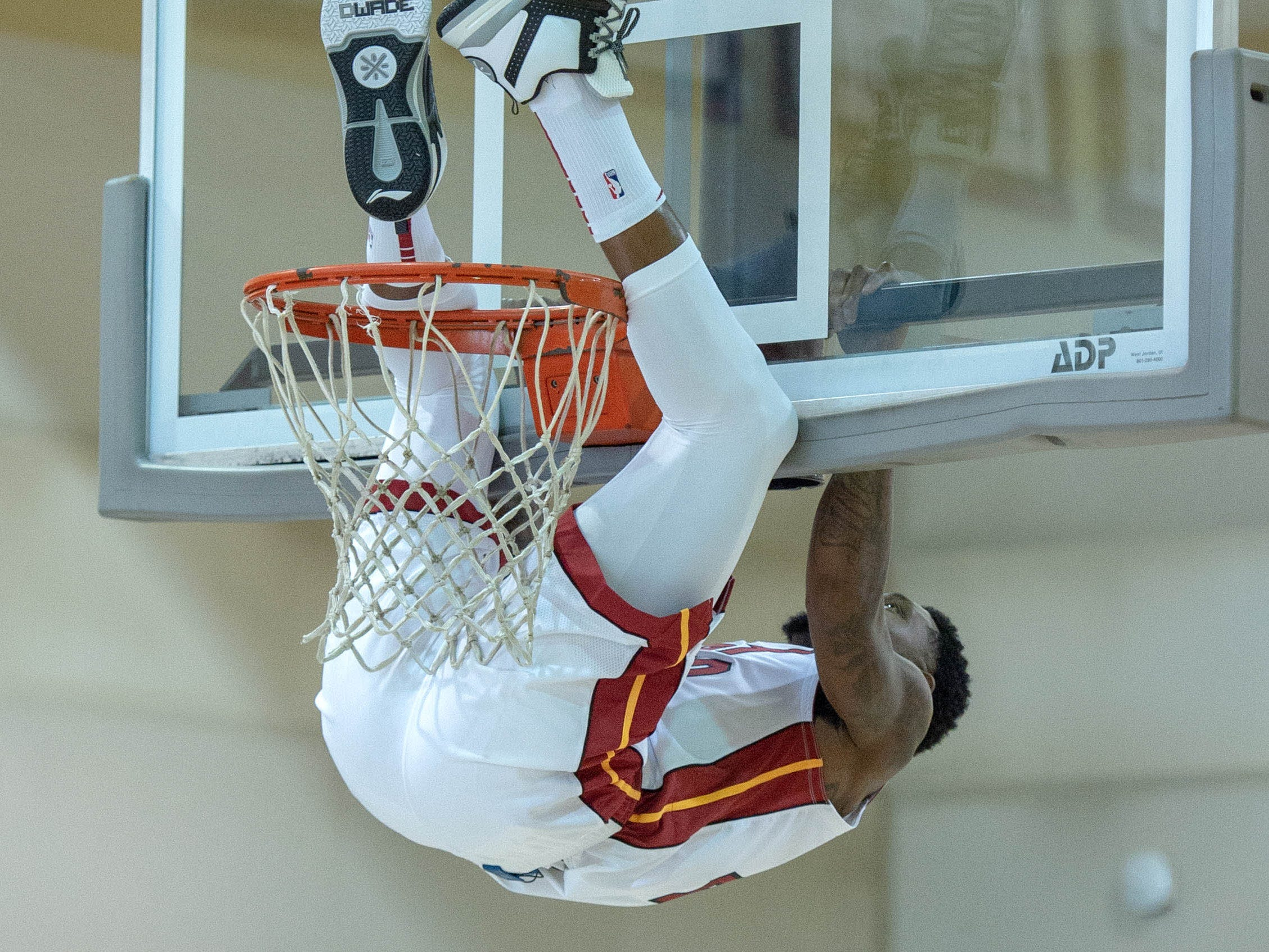 Miami Heat forward Udonis Haslem hangs on the rim during media day.