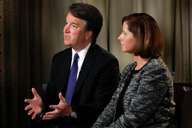 Brett Kavanaugh, with his wife Ashley Estes Kavanaugh, answers questions during a FOX News interview, Monday, Sept. 24, 2018, in Washington, about allegations of sexual misconduct against the Supreme Court nominee.
