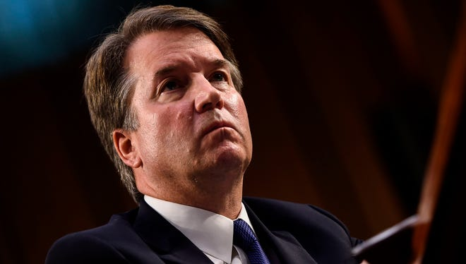 In this file photo taken on Sept. 4, 2018, Judge Brett Kavanaugh looks on during his Senate Judiciary Committee confirmation hearing to be an Associate Justice on the Supreme Court, on Capitol Hill in Washington.