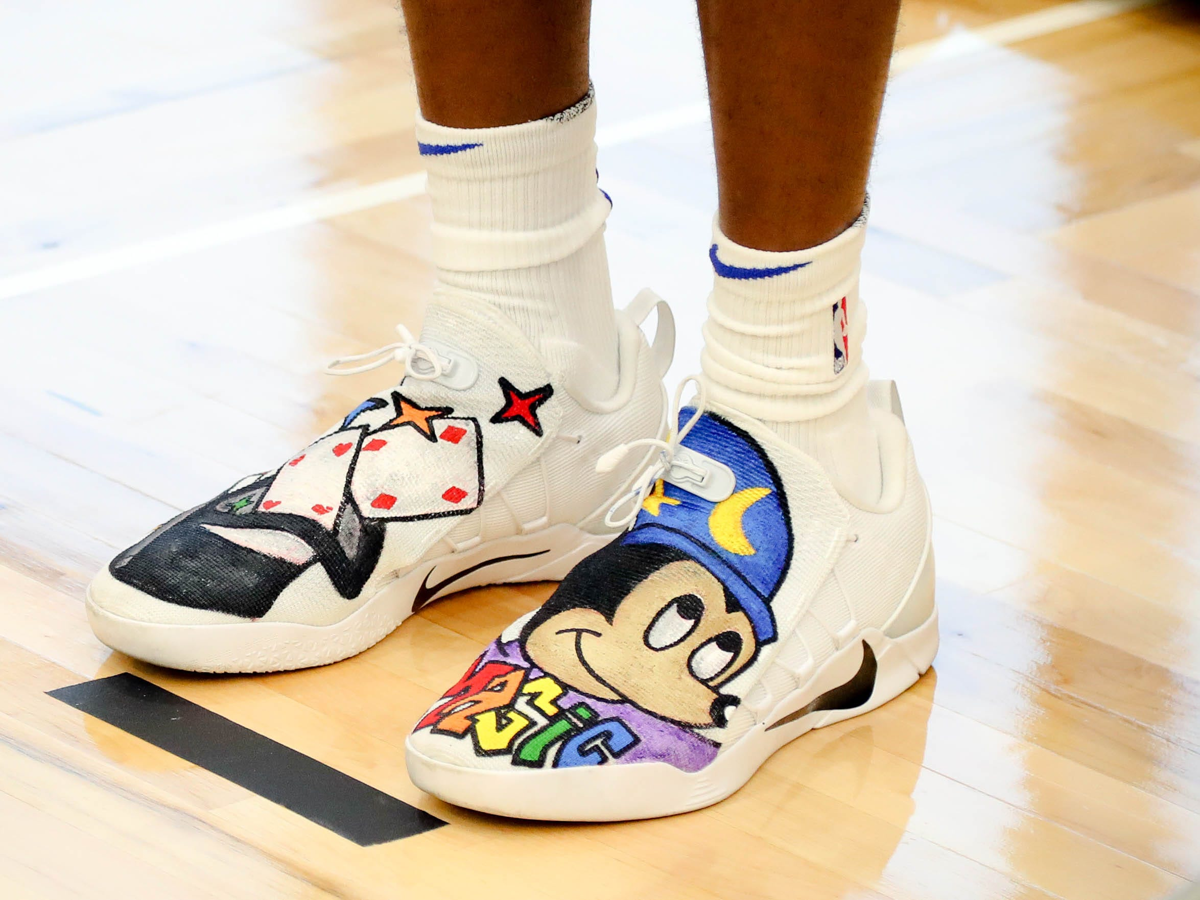 A detail view of Orlando Magic forward Melvin Frazier Jr. (35) sneakers with Mickey Mouse.