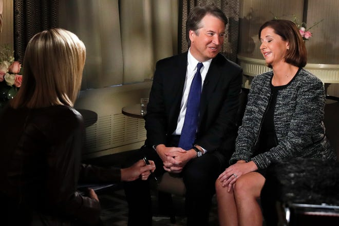 Brett Kavanaugh looks at his wife Ashley Estes Kavanaugh at the start of a FOX News interview with Martha MacCallum, Monday, Sept. 24, 2018, in Washington, about allegations of sexual misconduct against the Supreme Court nominee.