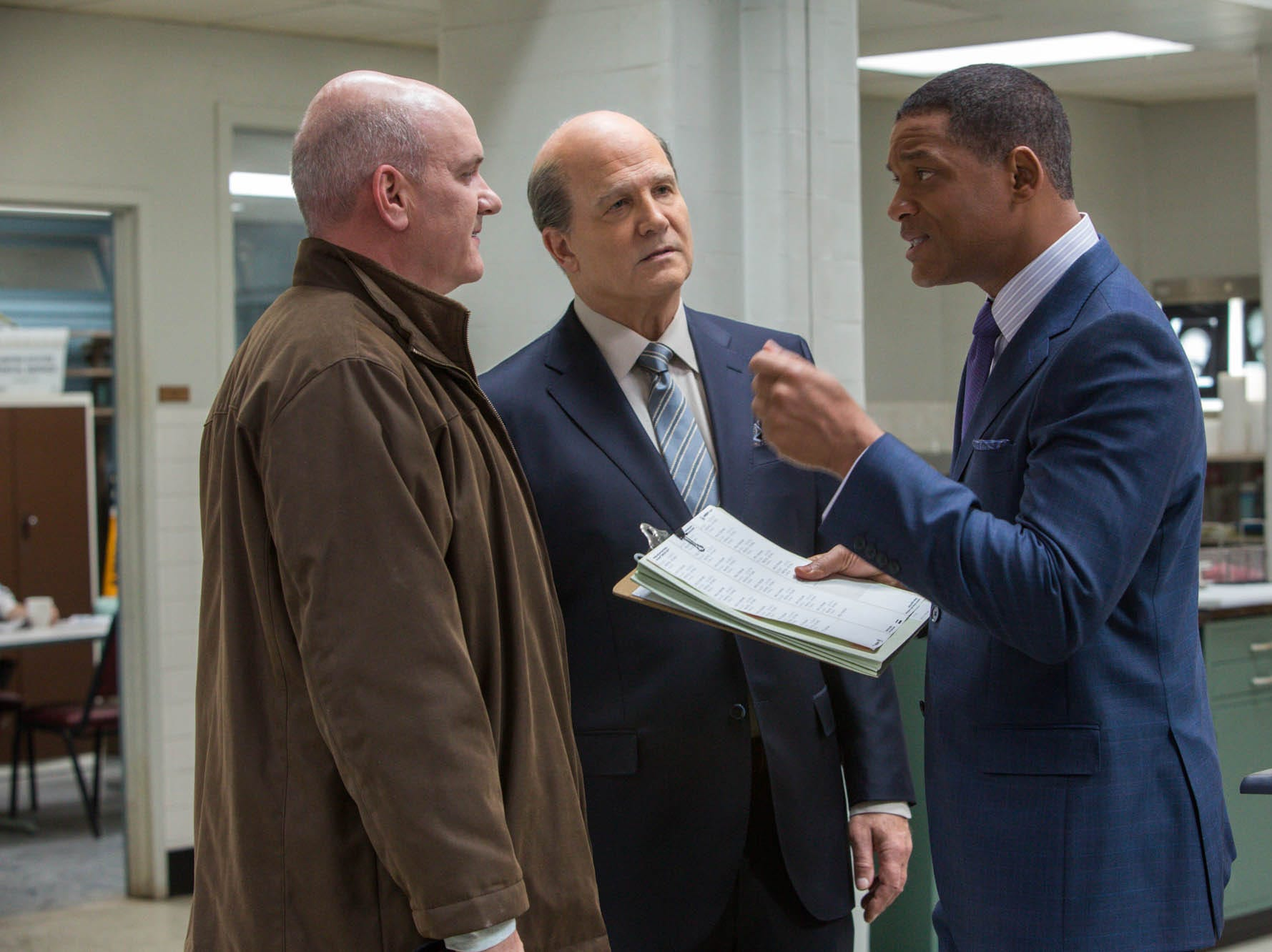 "Mike O'Malley, Albert Brooks and Will Smith in ""Concussion."""