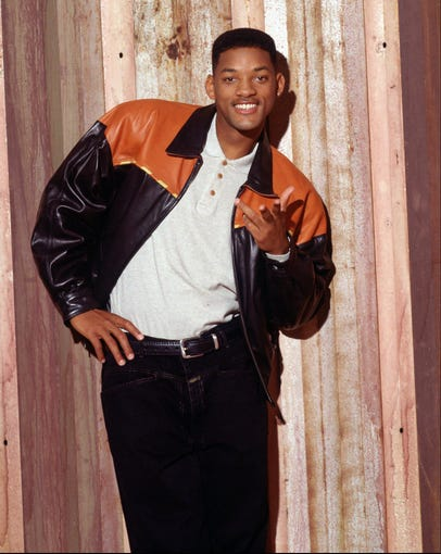 "Will Smith has become a bonafide Hollywood icon. The actor and rapper is as well known for his roles in big-budget movies and TV shows as he is for his equally successful family. Look back at the star through the years, including this shot from his days as the star of '90s sitcom ""The Fresh Prince of Bel-Air."""