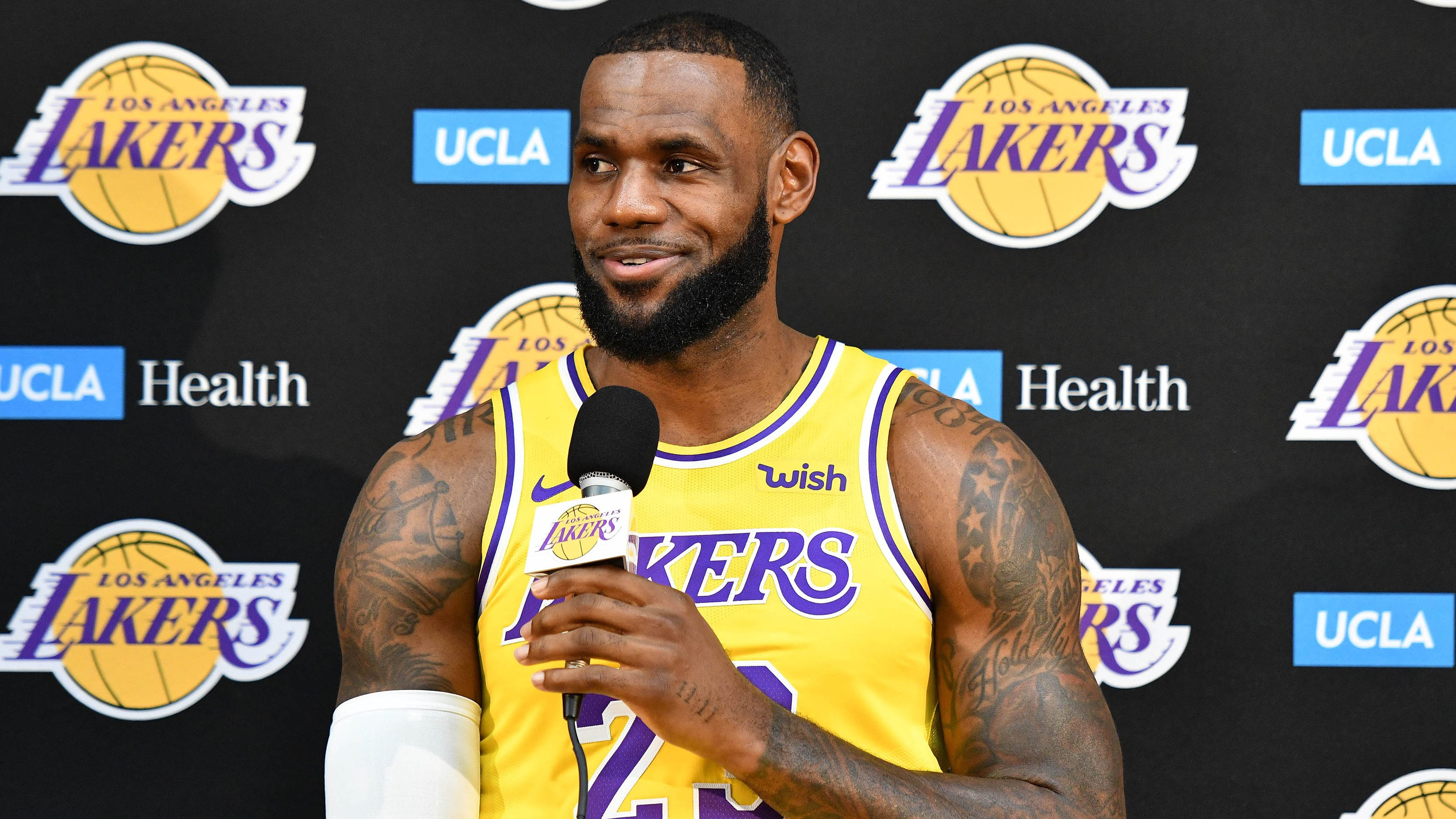 LeBron James answers a question during an...