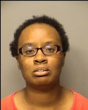 School bus driver Joandrea McAtee, 27, of Portage, Ind., in arrest photo.