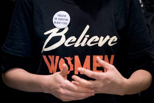 "A woman wears a shirt that reads ""Believe Women"" with a button that reads ""I Believe Dr. Christine Blasey Ford"" as protesters against Supreme Court nominee Brett Kavanaugh tell their personal stories of sexual assault outside offices of Sen. Jeff Flake, R-Ariz., on Capitol Hill in Washington, Monday, Sept. 24, 2018, as the Senate begins a week of scrutiny of President Donald Trump's nominee to the high court. Judge Brett Kavanaugh's nomination to the U.S. Supreme Court has been further imperiled by a second sexual-misconduct allegation, dating to his first year at Yale University. (AP Photo/Andrew Harnik) ORG XMIT: DCAH123"