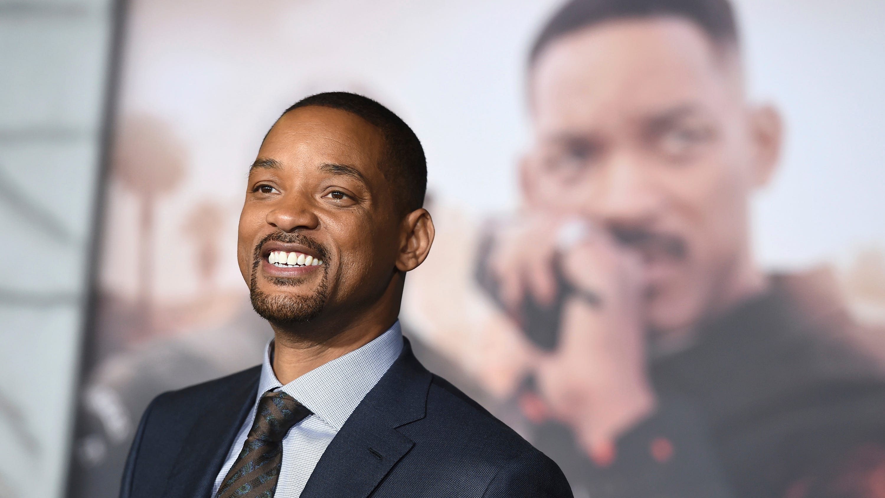"In this Dec. 13, 2017, file photo, Will Smith arrives at the U.S. premiere of ""Bright"" in Los Angeles. When Smith turns 50 on Tuesday, Sept. 25, 2018, he will jump head-first into the big milestone. The ""Fresh Prince"" plans to bungee jump from a helicopter over a gorge just outside Grand Canyon National Park. His birthday activity is the latest in a vast history of outrageous stunts staged in and around one of the worlds seven natural wonders."
