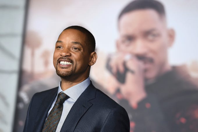 """In this Dec. 13, 2017, file photo, Will Smith arrives at the U.S. premiere of """"Bright"""" in Los Angeles. When Smith turns 50 on Tuesday, Sept. 25, 2018, he will jump head-first into the big milestone. The """"Fresh Prince"""" plans to bungee jump from a helicopter over a gorge just outside Grand Canyon National Park. His birthday activity is the latest in a vast history of outrageous stunts staged in and around one of the worlds seven natural wonders."""
