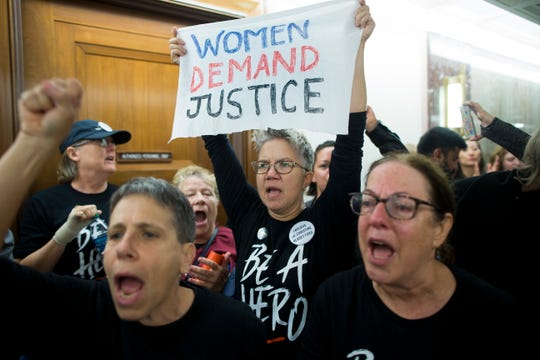 Protesters outside the office of Democratic Senator from California Dianne Feinstein demonstrate in opposition to Brett Kavanaugh, the U.S. President Donald J. Trump's nominee to be a U.S. Supreme Court Associate Justice, on Capitol Hill in Washington, DC, Sept. 24. Kavanaugh has been accused of sexual misconduct by two women.