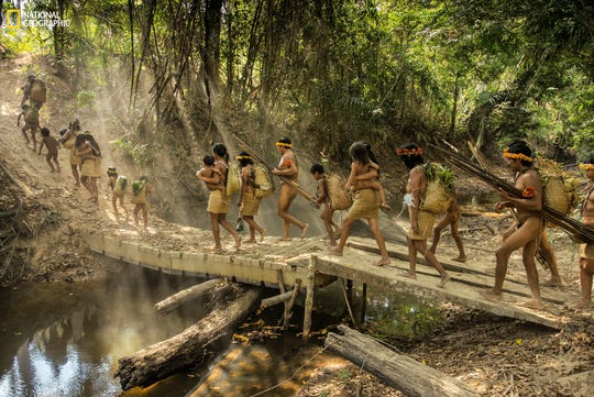 Charlie Hamilton James photographed the endangered tribes of the Amazon for the October 2018 issue of National Geographic magazine. Here 5 families from Posto An outpost created by the Brazilian government's Indigenous Affairs Agency set out on an overnight excursion into the forest.
