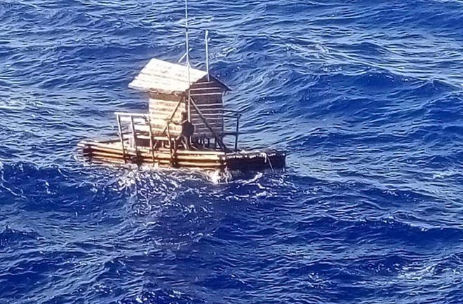 Aldi Novel Adilang is seen on a wooden fish trap floating in the waters near the island of Guam.