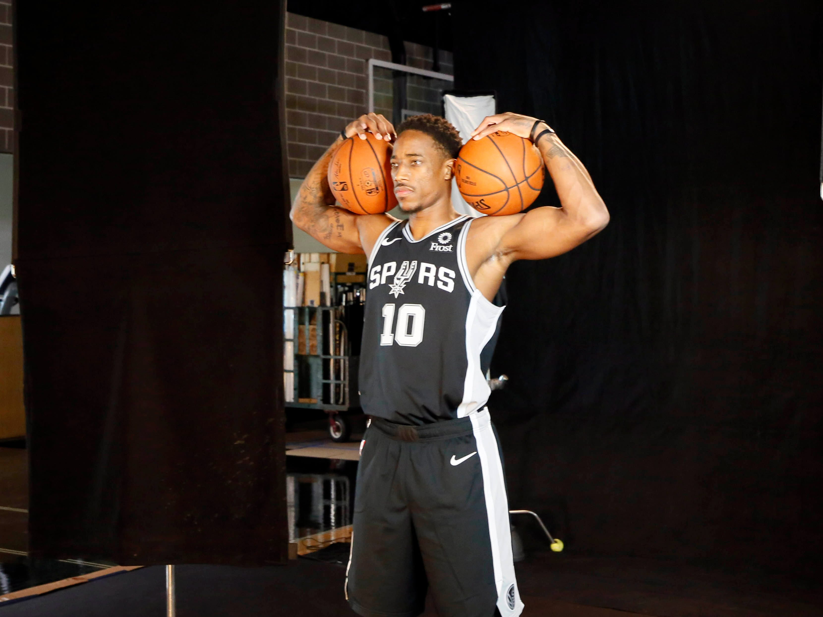 San Antonio Spurs shooting guard DeMar DeRozan (10) poses for a photo during media day.