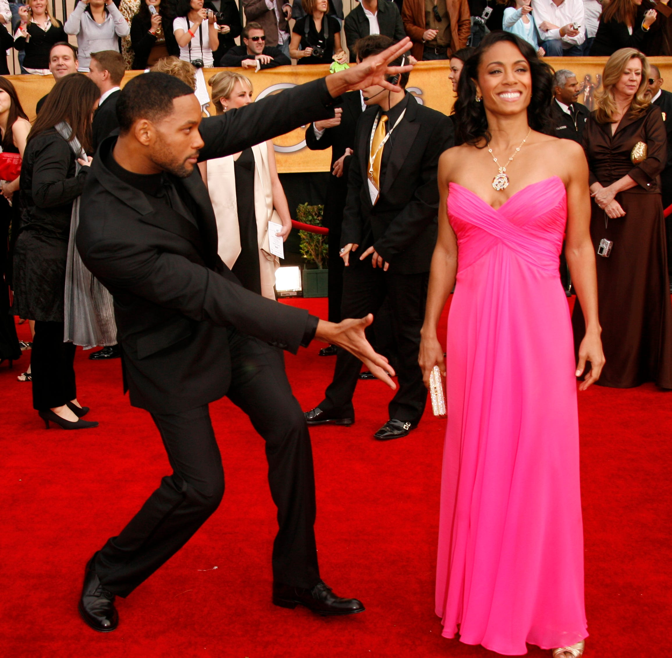 Will Smith and wife Jada Pinkett Smith pose for photographers at he 13th annual Screen Actors Guild Awards show at the Shrine Exposition Center in Los Angeles on Jan. 28, 2007.
