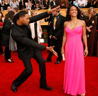 Will Smith and his wife Jada Pinkett Smith pose for photographers at the 13th annual Screen Actors Guild Awards at the Shrine Exposition Center in Los Angeles on January 28, 2007.