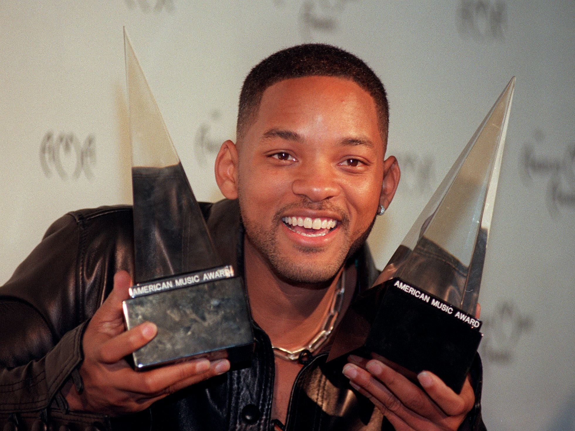 Actor and Recording star Will Smith holds up two of the three awards he won at The American Music Awards at the Shrine Auditorium in Los Angeles, Calif. on 11 Jan. 11, 1999. Smith won awards for Pop Rock Favorite Album, Soul, Rhythm and Blues Favorite Album, and Favorite Male Artist.
