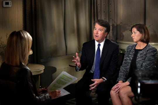 Brett Kavanaugh answers questions about allegations of sexual misconduct against the Supreme Court nominee during a Fox News interview with Martha MacCallum, left, Sept. 24, 2018, in Washington. At right is Kavanaugh's wife, Ashley Estes Kavanaugh.