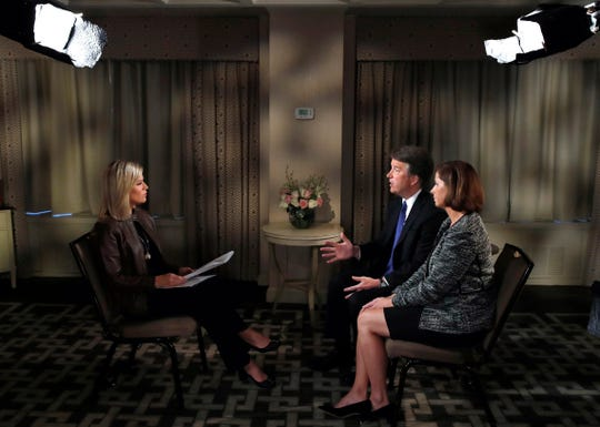 Brett Kavanaugh and his wife Ashley Estes Kavanaugh answer questions during a FOX News interview with Martha MacCallum, Monday, Sept. 24, 2018, in Washington, about allegations of sexual misconduct against the Supreme Court nominee.