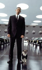 "Will Smith and Frank the Pug in a scene from the motion picture ""Men in Black II."""