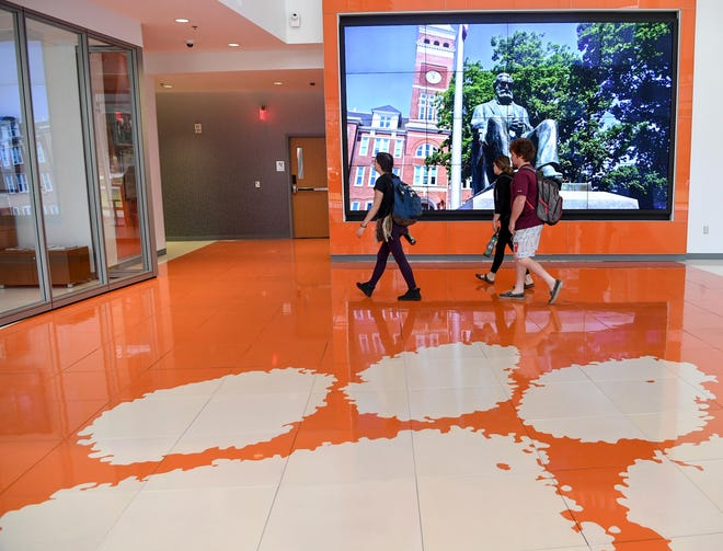 Students walk around the Watt Family Innovation Center at Clemson University in Clemson in September. The technology-enhanced academic building, featuring state-of-the-art information technology was stablished in 2016 with the support of more than $25 million in corporate donations.